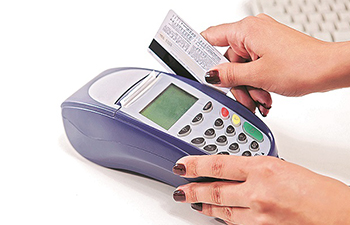 How does mobile app help to realise the cashless economy?